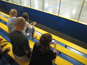 Parents taking in little Dylan's hockey game.