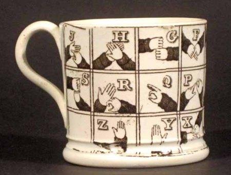 a-pearlware-tankard-decorated-with-sign-language-circa-1820-earle-d-vandekar-vm98038